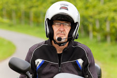 Motorcyclist with headset Royalty Free Stock Photography