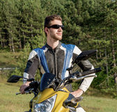 Motorcyclist and helmet Royalty Free Stock Photography