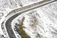 Motorcyclist On High Mountain Road. Motorcyclist riding high up on Transfagarasan road stock photos