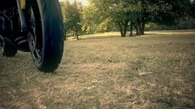 Motorcyclist on a lawn stock footage