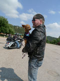 Motorcyclist with little dog, Aladdin, Wyoming Stock Photo