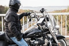 Motorcyclist looks at the highway royalty free stock image
