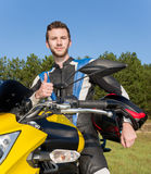 Motorcyclist makes ok sign Stock Images