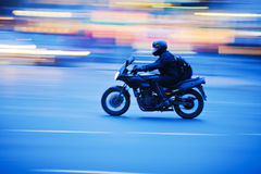 Motorcyclist in motion Royalty Free Stock Images