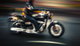 Motorcyclist in motion blur Stock Photos