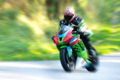 Motorcyclist in motion Stock Images