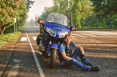 Motorcyclist with motorbike stock images