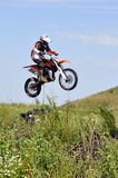 The motorcyclist on the motorcycle carries out a jump against th Stock Photos