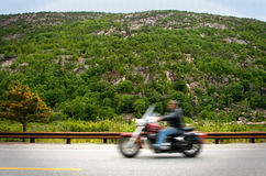 Motorcyclist on mountain road Stock Photo