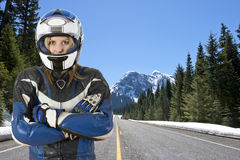 Motorcyclist on mountain road Royalty Free Stock Photography