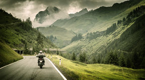 Motorcyclist on mountainous highway Royalty Free Stock Images