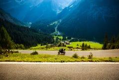 Motorcyclist on mountainous highway Royalty Free Stock Photo