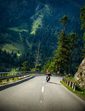 Motorcyclist on mountainous road Royalty Free Stock Image