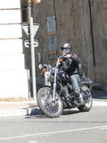 Motorcyclist navigates the narrow streets Royalty Free Stock Images