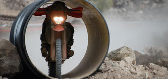 A motorcyclist passes through the tube Royalty Free Stock Photography