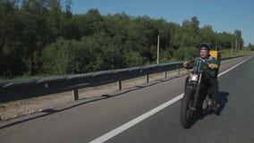 Motorcyclist posing on camera stock footage