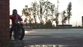 Motorcyclist preparing to leave stock video footage