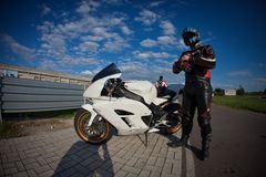 Motorcyclist preparing to start the race royalty free stock photos
