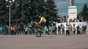 Motorcyclist on a Quad bike performs beautiful stunts on a Quad bike in front of the audience. Nice motor show. General plan. stock footage