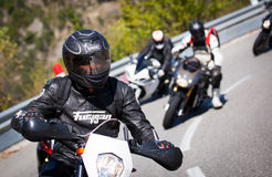 Motorcyclist racers in alps Stock Photo