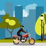 Motorcyclist racing on bike in city Stock Image