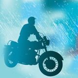 Motorcyclist In The Rain Stock Photography