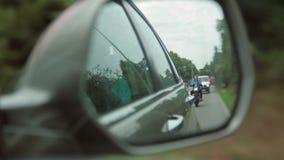 Motorcyclist in rear window stock video footage