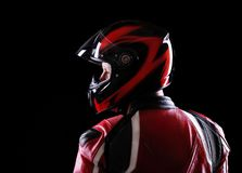 Motorcyclist in red equipment back view Stock Photos