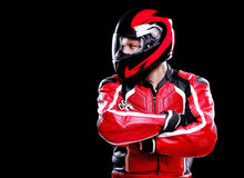 Motorcyclist in red equipment Royalty Free Stock Photography