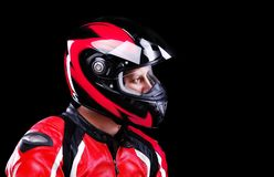 Motorcyclist in red equipment Royalty Free Stock Images