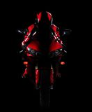 Motorcyclist in red equipment Stock Image