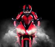 Motorcyclist in red equipment Stock Photos