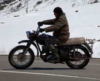 Motorcyclist in retro-bike Stock Images