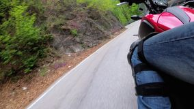 Motorcyclist Rides along on the Scenic Mountain Curve Road in Italy. Side view. POV. Motorcyclist Rides along on the Scenic Mountain Curve Road in Italy. Side stock video