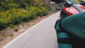 Motorcyclist Rides along on the Scenic Mountain Curve Road in Italy. Side view. POV. Motorcyclist Rides along on the Scenic Mountain Curve Road in Italy. Side stock video footage