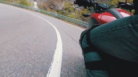 Motorcyclist Rides along on the Scenic Mountain Curve Road. Side view. POV. Motorcyclist Rides along on the Scenic Mountain Curve Road. Side view of a stock footage
