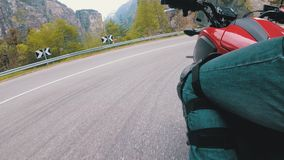 Motorcyclist Rides along on the Scenic Mountain Curve Road. Side view. POV. Motorcyclist Rides along on the Scenic Mountain Curve Road. Side view of a stock video