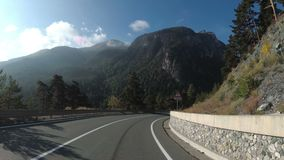 Motorcyclist Rides on a Beautiful Landscape Mountain Road in Europe. First Person view. Motorcyclist Rides on a Beautiful Landscape Mountain Road in Europe stock footage