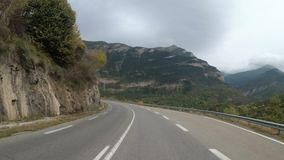 Motorcyclist Rides on a Beautiful Landscape Mountain Road in France. Rainy weather. First person view. Motorcyclist Rides on a Beautiful Landscape Mountain Road stock footage