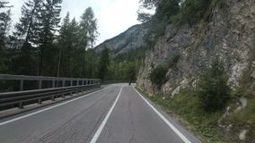 Motorcyclist Rides on a Beautiful Landscape Mountain Road in Italy. First person view. Motorcyclist Rides on a Beautiful Landscape Mountain Road in Italy. First stock footage