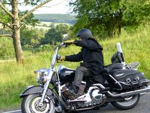 Motorcyclist goes downhill 2 royalty free stock photo