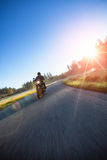 Motorcyclist riding chopper on a road stock photography