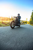 Motorcyclist riding  chopper on a road Royalty Free Stock Images