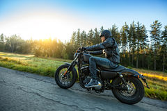 Motorcyclist riding  chopper on a road Royalty Free Stock Photo