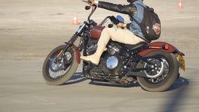 Motorcyclist riding a motorcycle Harley Davidson