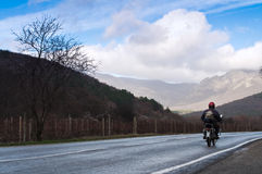 Motorcyclist on the road Royalty Free Stock Photo