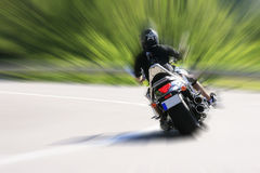 Motorcyclist on road. Motorcyclist running on road with speed Royalty Free Stock Image
