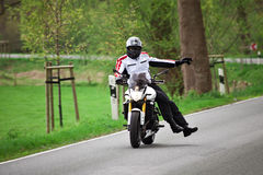 Motorcyclist on the road Stock Photography