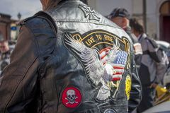 A motorcyclist`s jacket. Detail of the leather handkerchief of an Italian biker. Coat of arms and colorful colors of this lifestyle royalty free stock images