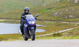Motorcyclist in the Scottish Highlands Stock Photo